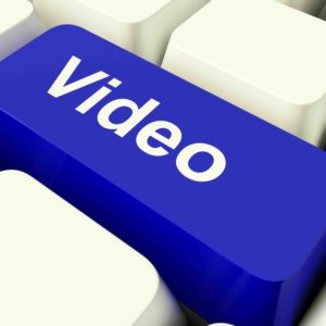 Videos Computer Key In Blue Showing Dvds Or Multimedia